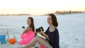 Family taking photos at the beach