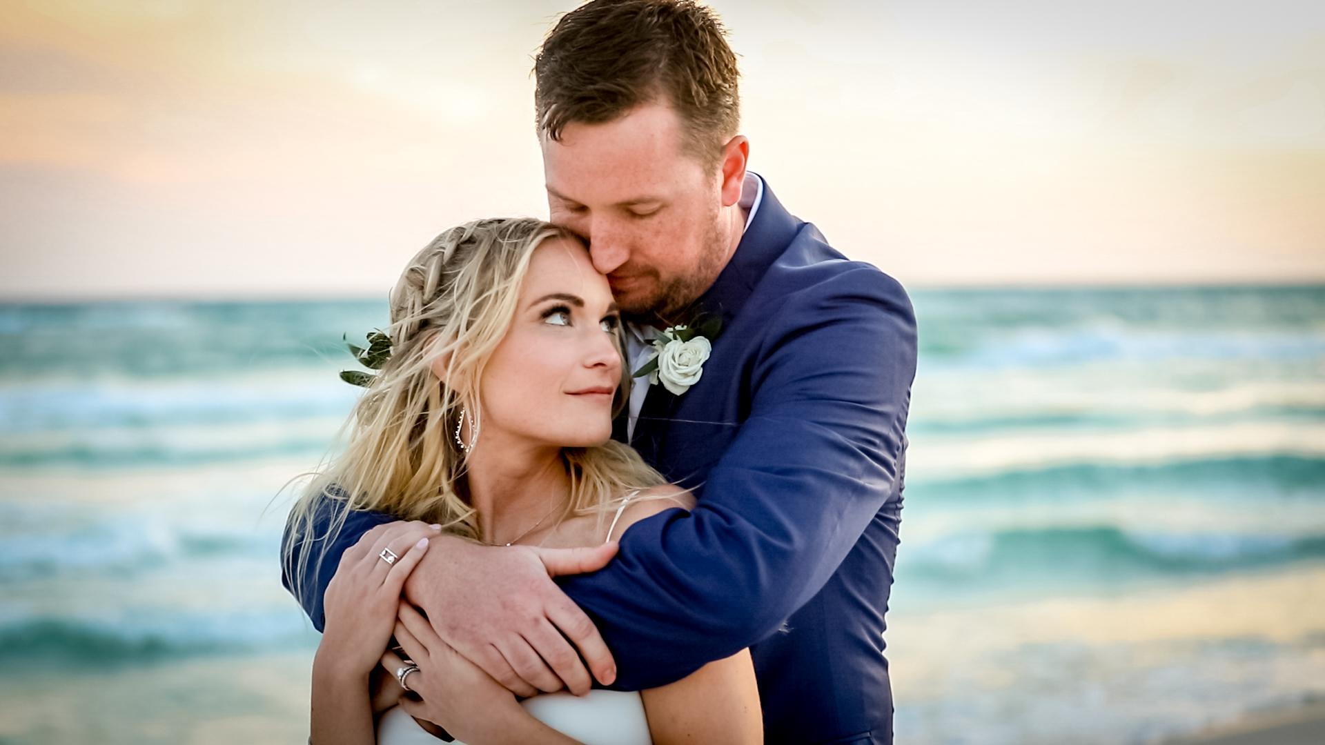 bride and groom wedding portraits on the beach in Seaside, Florida
