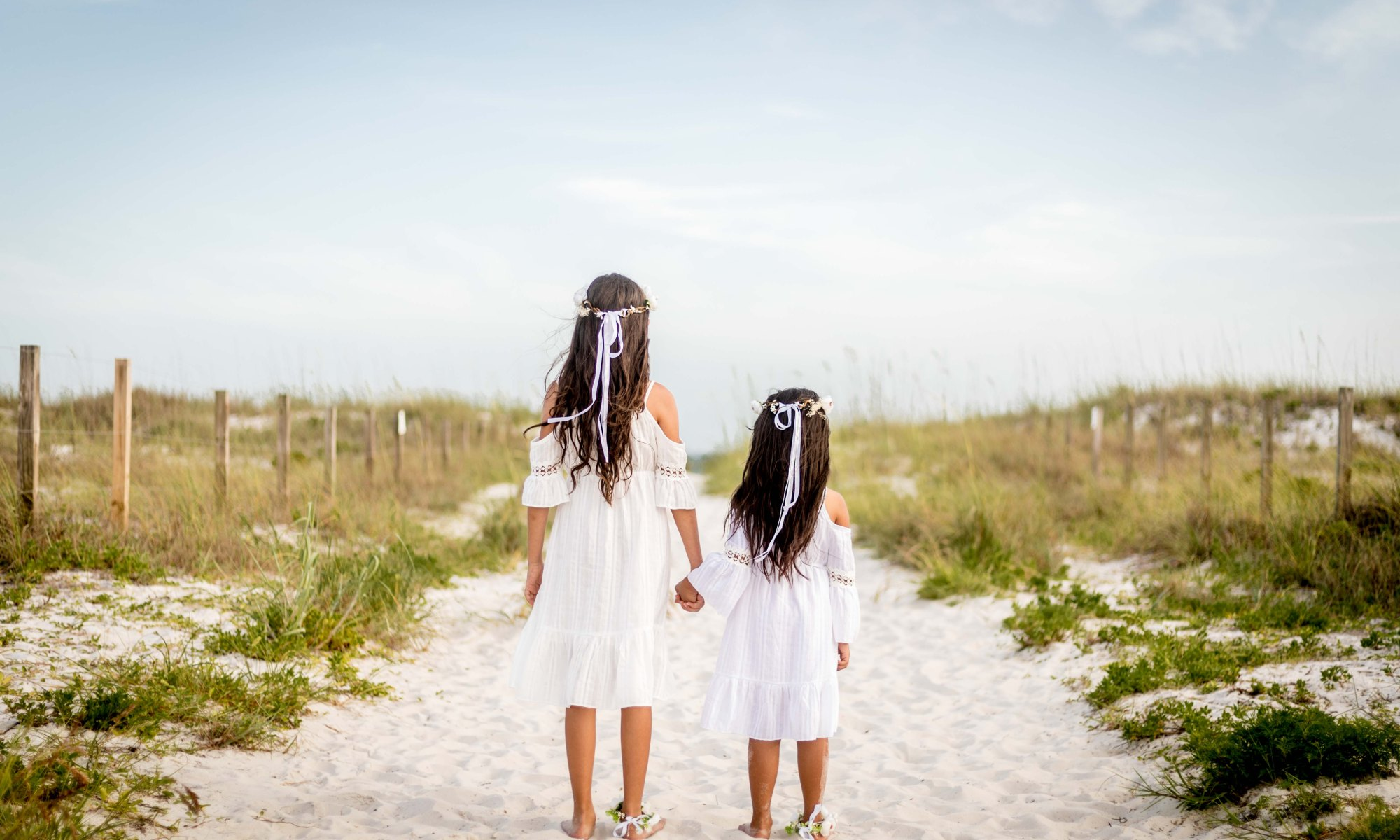 sisters on the beach for their parents' vow renewal ceremony