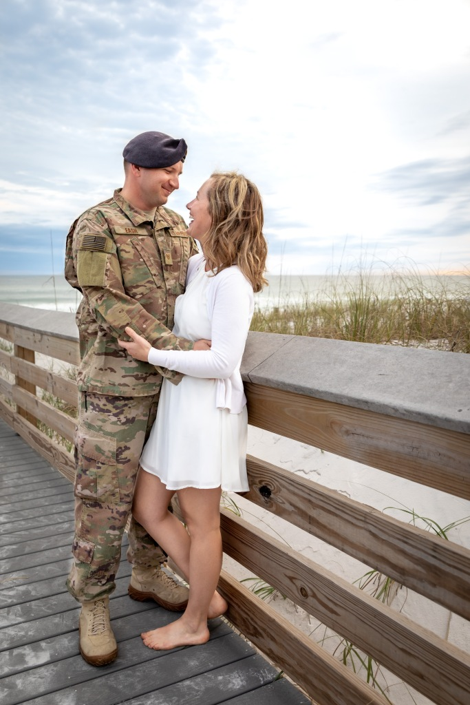 husband and wife beach portrait on boardwalk